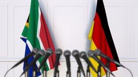 Bandiere del Sudafrica e della Germania alla riunione o alla conferenza internazionale rappresentazione 3d Immagine Stock Libera da Diritti