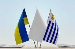 Bandiere dell'Ucraina e dell'Uruguay fotografia stock