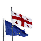 Bandiere di Georgia e di Unione Europea Fotografia Stock