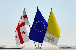 Bandiere di Georgia European Union e di Città del Vaticano fotografia stock libera da diritti