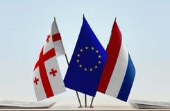Bandiere di Georgia European Union e dei Paesi Bassi Fotografia Stock