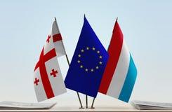 Bandiere di Georgia European Union e del Lussemburgo Immagini Stock