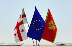 Bandiere di Georgia European Union e del Montenegro fotografia stock libera da diritti