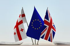 Bandiere di Georgia European Union e del Regno Unito della Gran Bretagna fotografia stock