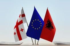 Bandiere di Georgia European Union e dell'Albania fotografia stock libera da diritti