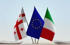 Bandiere di Georgia European Union e dell'Italia Fotografia Stock