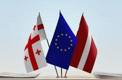 Bandiere di Georgia European Union e della Lettonia Fotografia Stock