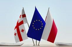 Bandiere di Georgia European Union e della Polonia immagine stock libera da diritti