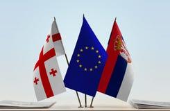 Bandiere di Georgia European Union e della Serbia Fotografie Stock Libere da Diritti