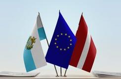 Bandiere di San Marino European Union e della Lettonia fotografia stock libera da diritti