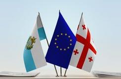 Bandiere di San Marino European Union e di Georgia fotografie stock libere da diritti