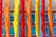 Bandiere festive dei colori differenti Immagini Stock