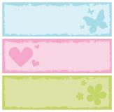 Bandiere Grungy con le farfalle, cuori, fiori Immagini Stock