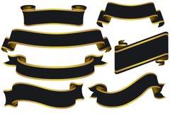 Bandiere nere con oro Fotografia Stock