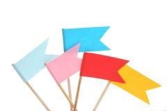 Bandiere variopinte su fondo bianco Fotografia Stock