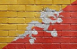 Bandierina del Bhutan sul muro di mattoni Fotografia Stock Libera da Diritti