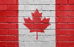 Bandierina del Canada sul muro di mattoni Fotografia Stock
