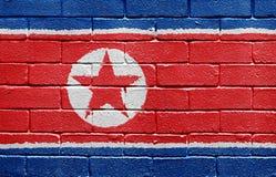 Bandierina del Korea di Nord sul muro di mattoni immagine stock libera da diritti