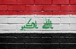 Bandierina dell'Iraq sul muro di mattoni fotografie stock libere da diritti
