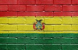 Bandierina della Bolivia sul muro di mattoni Immagini Stock