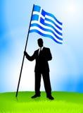 Bandierina della Grecia della holding della guida dell'uomo d'affari Fotografia Stock