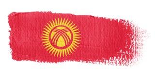 Bandierina Kirghizstan di Brushstroke Fotografie Stock Libere da Diritti