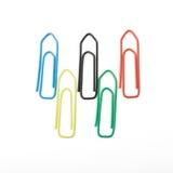 Bandierina olimpica fatta dei paperclips isolati su bianco Fotografie Stock