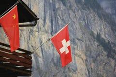 Bandierina svizzera alpi immagine stock
