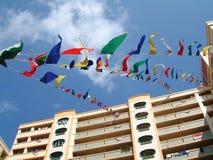 Bandierine che volano celebrando giorno nazionale Fotografia Stock Libera da Diritti