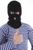 Bandiet, duimen omhoog Royalty-vrije Stock Afbeeldingen