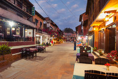 Bandipur Bazaar. BANDIPUR, NEPAL - 21 December 2016: Cafes and restaurants at twilight, 21 December 2016 in Bandipur, Nepal Royalty Free Stock Photo