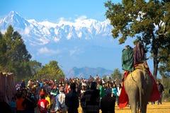 Bandipur Festival Himalayan Mountain Background. Bandipur, Nepal - December 17, 2007: Beautiful Himalayan mountain range backdrop at local Nepali festival in Stock Photos