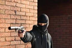 Bandit armé photos stock