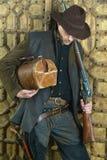 Bandit avec l'arme à feu Photographie stock