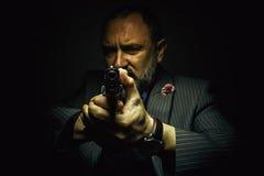 Bandit avec l'arme à feu Image libre de droits