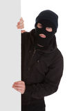 Bandit In Black Mask With Blank Card. Man Wearing Mask Holding A Blank Card Over White Background Stock Photography