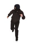 Bandit in black mask running away Royalty Free Stock Photo