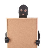 Bandit with empty corkboard Royalty Free Stock Photos