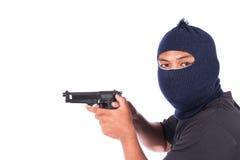 Bandit med vapnet i hand fotografering för bildbyråer