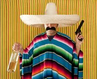 Bandit Mexican revolver mustache drunk tequila. Bottle sombrero Stock Photo