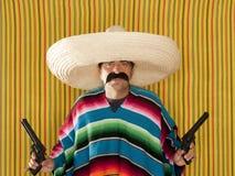 Bandit Mexican revolver mustache gunman sombrero. Poncho serape Royalty Free Stock Photo