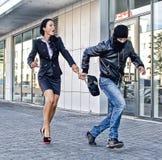 Bandit stealing bag Stock Image