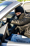 Bandit stealing a car. Stock Photography
