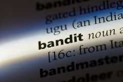 Bandit. Word in a dictionary.  concept royalty free stock photography