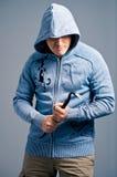 Bandito aggressivo con un bastone a leva Fotografia Stock Libera da Diritti