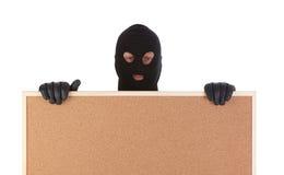 Bandito con il corkboard Fotografia Stock Libera da Diritti