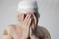 Bandits mutilated man Stock Photos