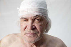 Bandits mutilated man Stock Photography
