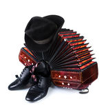 Bandoneon, black hat and tango shoes on white Stock Image