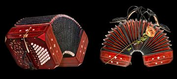 Bandoneon, tango instrument. Bandoneon, argentine tango instrument, double view, isolated on black Royalty Free Stock Photos